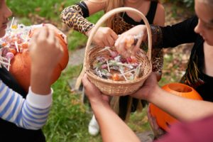children getting candy from a wicker basket